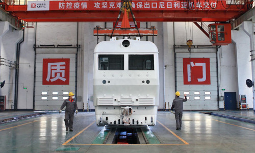 A factory in Changzhou, China, where workers assemble locomotives made in conformance with Chinese industrial standards, and slated for export to Nigeria.